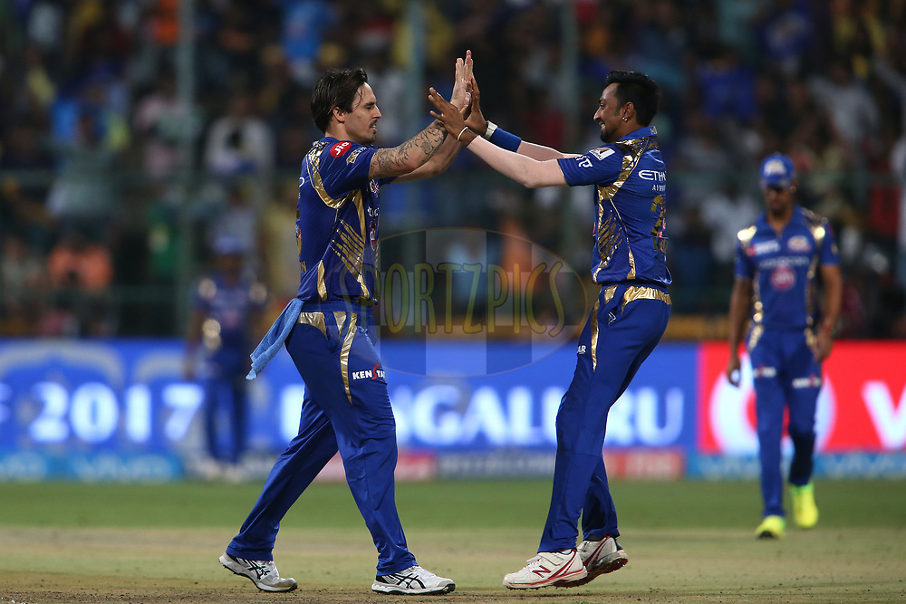 Mitchell Johnson of the Mumbai Indians is congratulated by Krunal Pandya of the Mumbai Indians for getting Piyush Chawla of the Kolkata Knight Riders wicket during the 2nd qualifier match of the Vivo 2017 Indian Premier League between the Mumbai Indians and the Kolkata Knight Riders held at the M.Chinnaswamy Stadium in Bangalore, India on the 19th May 2017<br /> <br /> Photo by Shaun Roy - Sportzpics - IPL