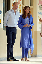 The Duke and Duchess of Cambridge during a visit to a government-run school in central Islamabad on day two of the royal visit to Pakistan.