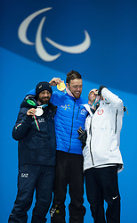March 12, 2018 - Pyeongchang, South Korea - Left to right, silver medalist Manuel Pozzerle of Italy (bronze), Simon Patmore of Australia (gold) and Mike Minor of the US celebrate during a medal ceremony for Men's Snowboard Cross Monday, March 12, 2018 at the Medals Plaza for the 2018 Pyeongchang Winter Paralympic Games. Photo by Mark Reis (Credit Image: © Mark Reis via ZUMA Wire)