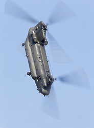 © Licensed to London News Pictures. 12/07/2014. RAF Fairford UK. An RAF Chinook Performs at the Royal International Air Tattoo at RAF Fairford. Photo credit : Ian Schofield/LNP