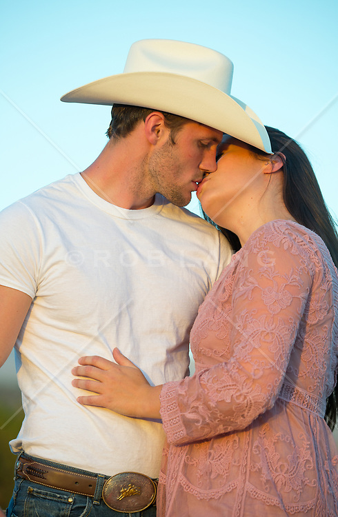 cowboy and a girl kissing