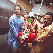 Bried being carried by her relatives  during a bengali wedding.