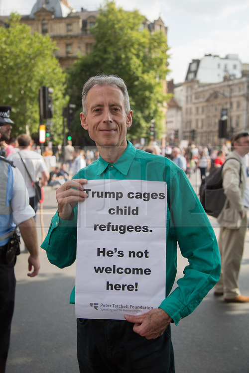 @Licensed to London News Pictures 13/07/2018. London, UK. Peter Tatchell the British human rights campaigner attends the Anti-Trump march today in London. Demonstrators march through the streets of Central London arriving at Trafalgar Square in protest to the US President Donald Trump' visit to the UK.Photo credit: Manu Palomeque/LNP