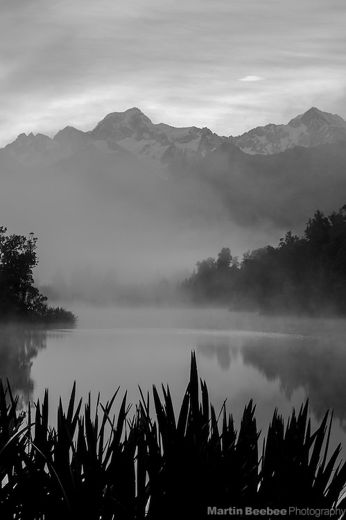 Mount Tasman and Mount Cook above Lake Matheson, Westland National Park, New Zealand