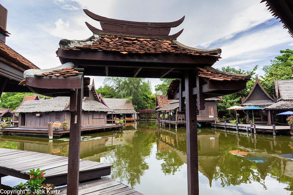 16 JULY 2014 - SAMUT PRAKAN, SAMUT PRAKAN, THAILAND: The entrance to the floating market and village in Ancient Siam. Ancient Siam is a historic park about 200 acres (81 hectares) in size in the city of Samut Prakan, province of Samut Prakan, about 90 minutes from Bangkok. It features historic recreations of important Thai landmarks and is shaped roughly like the country of Thailand.      PHOTO BY JACK KURTZ
