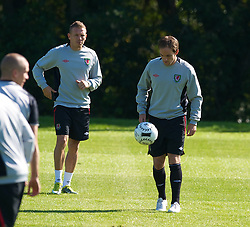 CARDIFF, WALES - Tuesday, August 31, 2010: Wales' captain Craig Bellamy and David Vaughan during training at the Vale of Glamorgan ahead of the UEFA Euro 2012 Qualifying Group 4 match against Montenegro. (Pic by David Rawcliffe/Propaganda)