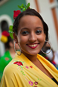 A young woman dressed in traditional Puerto Rican costume at the Festival of San Sebastian in San Juan, Puerto Rico.
