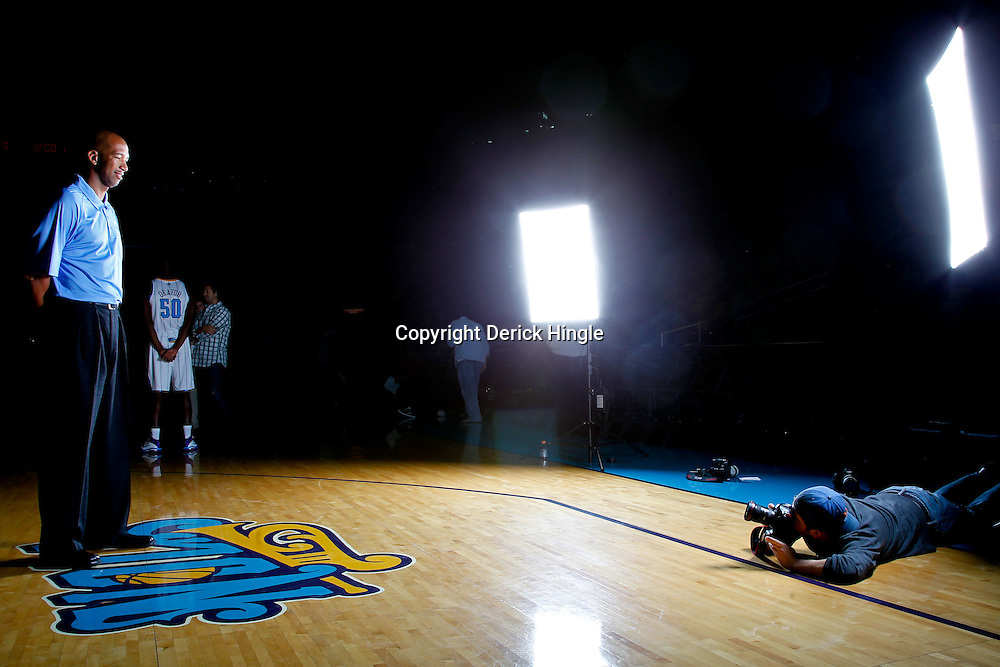 December 14, 2011; New Orleans, LA, USA; Photographer Jonathan Bachman shoots a portrait of New Orleans Hornets head coach Monty Williams during Media Day at the New Orleans Arena.   Mandatory Credit: Derick E. Hingle-US PRESSWIRE