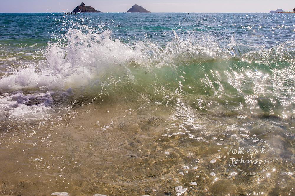Little splashy wave in foreground, Mokulua Islands in background, Kailua Bay, Oahu, Hawaii
