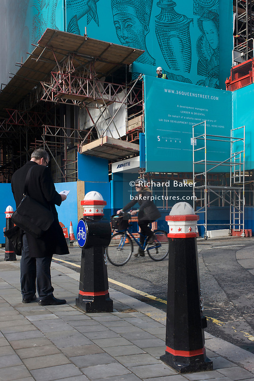 Historical construction hoarding in a side-street in the  financial City of London.
