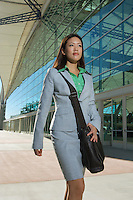 Businesswoman walking past office building