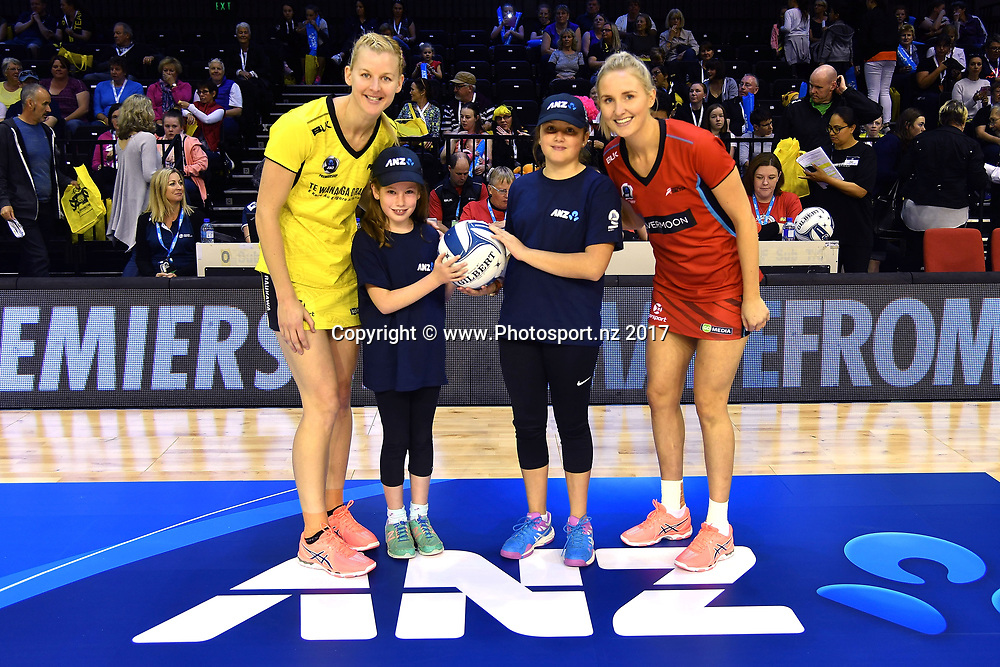 Pulse's captain Katrina Grant (L) with future captains Abigal Callaghan (Centre L), Harriet Pearce (Centre R) and Tactix's captain Hayley Saunders (R during the ANZ Premiership netball match between the Wellington Pulse vs Mainland Tactix at TSB Arena in Wellington on Sunday the 9th of April 2017. Copyright Photo by Marty Melville / www.Photosport.nz