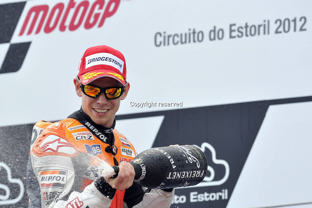 06.05.2012. Estoril, Portugal.  Motorcyle Grand Prix of Estoril.   Photo Casey Stoner on the podium with a champagne shower for the fans