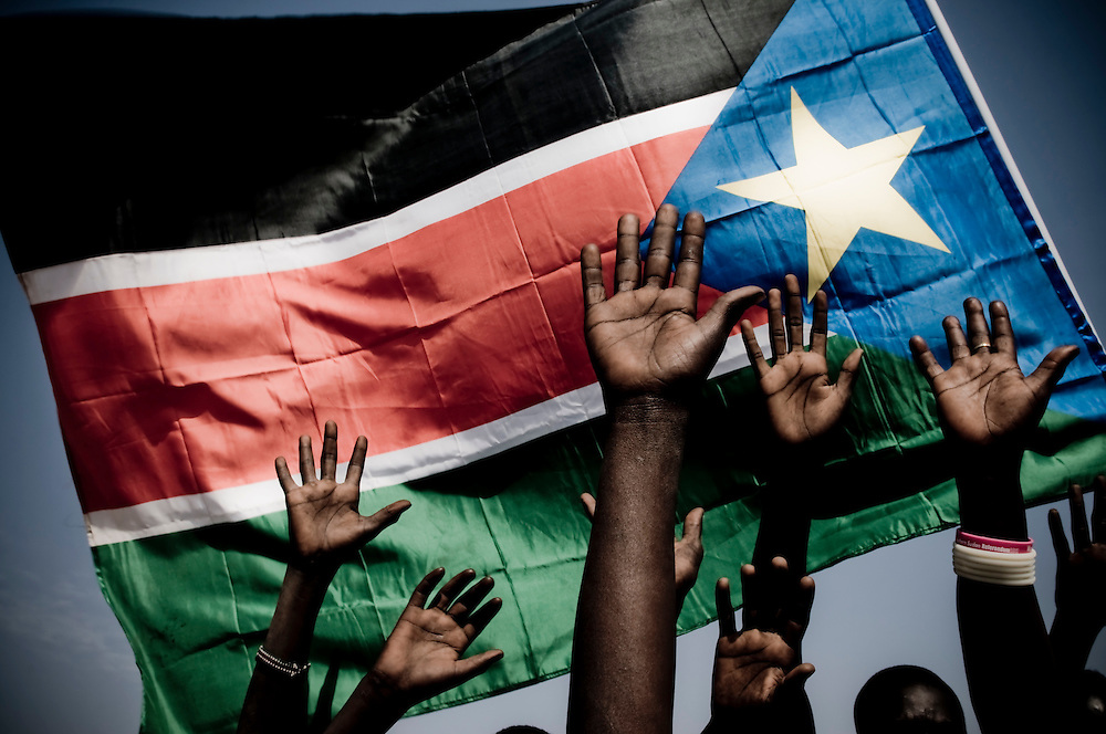Demonstrators at a voter's education seminar raise thier hands, the symbol of Southern Sudanese indepenence, in Southern Sudan's capital city Juba. Southern Sudan will vote on January 9 to decide whether or not to remain as part of Sudan or set off alone as the world's newest country. (© William B. Plowman)