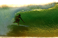 Indonesia - West Java - Genteng.New Zealand surfer enjoying a ride at the wave named 'Turtles', due to the dozens of Green Turtles who come ashore to lay their eggs each night.2005