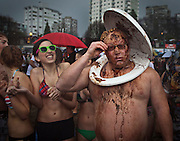 A participant dressed in a costume waits to take part in the 90th annual Polar Bear Swim in Vancouver, BC. (2010)