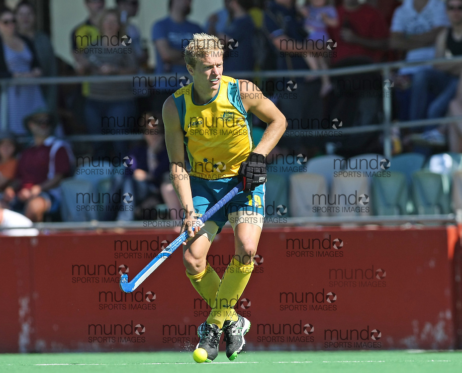 (Canberra, Australia---31 March 2012) Tim Deavin of the Australia Kookaburra national field hockey team paying the second of a three game field hockey test match series between Australia and Japan men's field hockey teams. 2012 Copyright Photograph Sean Burges / Mundo Sport Images.