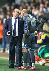 SWANSEA, WALES - Thursday, February 20, 2014: SSC Napoli's head coach Rafael Benitez speaks to goalkeeper Pepe Reina as he prepares to come on as a second half substitute against Swansea City during the UEFA Europa League Round of 32 1st Leg match at the Liberty Stadium. (Pic by David Rawcliffe/Propaganda)