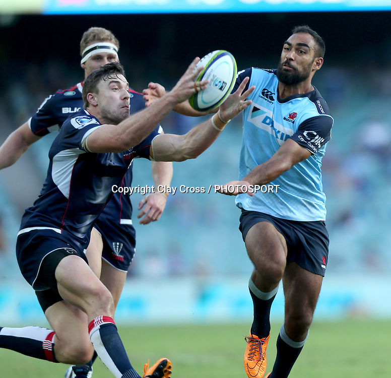 Cam Crawford grabs the ball out of the hands of Reece Robinson. Waratahs v Rebels, Super Rugby Round 6. Played at Allianz Stadium, Sydney Australia on Sunday 3 April 2016. Copyright Photo: Clay Cross / photosport.nz