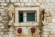 Window and headless statues, Sibenik, Croatia