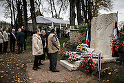 Villagers watch the brand new memorial after the first WWI armistice ceremony, on November 11, 2015 in Parigny la Rose. AFP PHOTO / JEFF PACHOUD