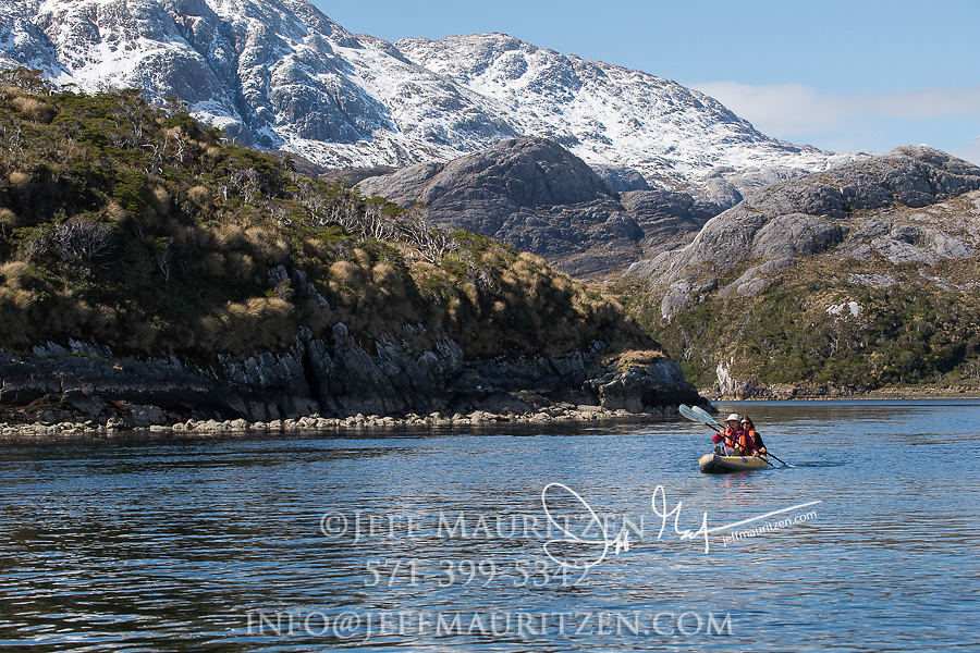 Kayakers near Bernal glacier (Benito glacier) located in Alacalufes National Reserve, Southern Chilean Fjords.
