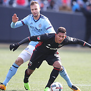 NEW YORK, NEW YORK - March 12:  Jose Guillermo Ortiz #9 of D.C. United is challenged by Maxime Chanot #4 of New York City FC during the NYCFC Vs D.C. United regular season MLS game at Yankee Stadium on March 12, 2017 in New York City. (Photo by Tim Clayton/Corbis via Getty Images)