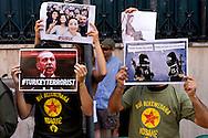 Roma 30 Luglio 2015<br /> Un gruppo di attivisti filo kurdi si è incatenato ai cancelli dell'ambasciata  della Turchia per protestare contro l' aggressione militare turca alla popolazione curda civile e i militanti del Pkk, contro l'ambiguità dei raid anti-Isis e anti-Pkk ,che Ankara ha portato a termine nei giorni scorsi e per ricordare le 32 vittime dell'attentato di Suruç.<br /> Rome 30 July 2015<br /> A group of Kurdish activists wire chained himself to the gates of the Embassy of Turkey to protest the attack Turkish military to civilian Kurdish population and PKK militants, against the ambiguity of the raid anti-Isis and anti-PKK, which Ankara completed in recent days and to remember the 32 victims of the Suruç.