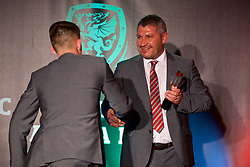 CARDIFF, WALES - Monday, October 2, 2017: Wales' assistant manager Osian Roberts presents Ben Woodburn with the FAW Young Player of the Year award during the FAW Awards Dinner at the Hensol Castle. (Pic by David Rawcliffe/Propaganda)