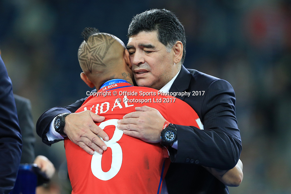 2nd July 2017 - FIFA Confederations Cup Final - Chile v Germany - Argentinian legend Diego Maradona consoles a dejected Arturo Vidal of Chile - Photo: Simon Stacpoole / Offside / www.photosport.nz