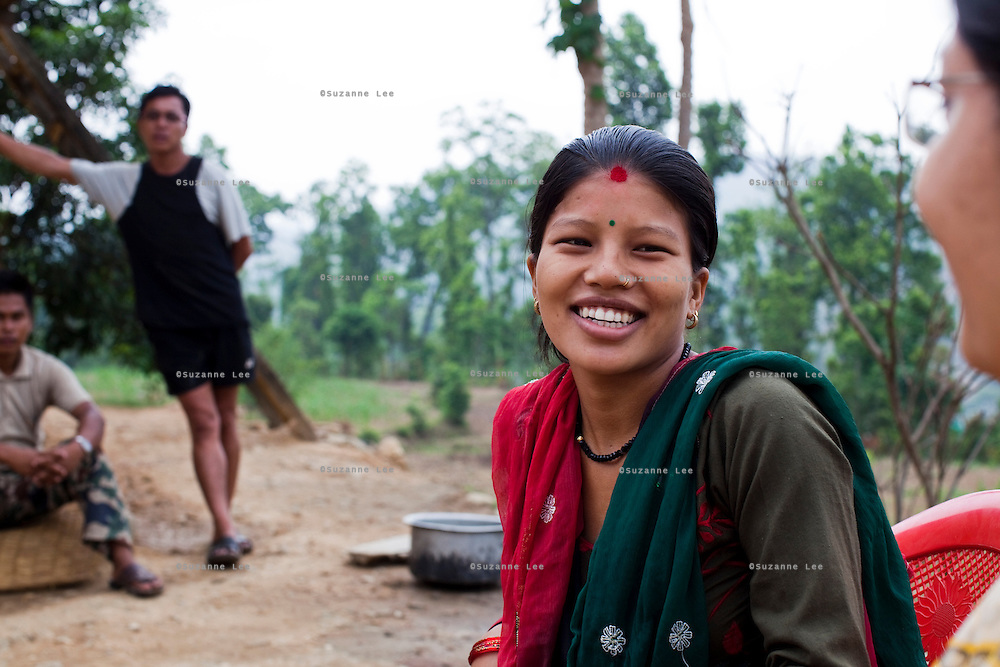 Nisha Darlami, 19, chats with Save the Children at her mother's house in Kalyan Village, Surkhet district, Western Nepal, on 30th June 2012. Nisha eloped with her step nephew when she was 13 but the couple used contraceptives for the next 6 years to delay pregnancy until she turned 18. Now 19, she has a one month old baby girl named Bushpa (flower). In Surkhet, StC partners with Safer Society, a local NGO which advocates for child rights and against child marriage. Photo by Suzanne Lee for Save The Children UK