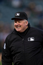 OAKLAND, CA - APRIL 07:  MLB umpire Bill Miller #26 looks on before the game between the Oakland Athletics and the Texas Rangers at O.co Coliseum on April 7, 2015 in Oakland, California. The Texas Rangers defeated the Oakland Athletics 3-1. (Photo by Jason O. Watson/Getty Images) *** Local Caption *** Bill Miller