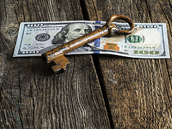 February 11, 2017 - vintage key on 100 dollars banknote on old wooden weavered background (Credit Image: © Igor Golovniov/ZUMA Wire)