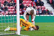 Fulham goalkeeper Marcus Bettinelli (1) gets a pat on teh back from Fulham defender Tim Ream (13) after saving the ball during the EFL Sky Bet Championship match between Middlesbrough and Fulham at the Riverside Stadium, Middlesbrough, England on 26 October 2019.