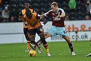 Hull City midfielder Mohammed Diame and Burnley midfielder Scott Arfieldduring the Sky Bet Championship match between Hull City and Burnley at the KC Stadium, Kingston upon Hull, England on 26 December 2015. Photo by Ian Lyall.