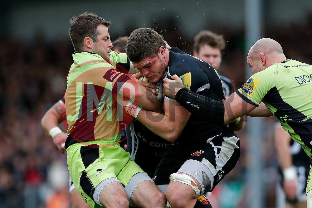 Exeter Chiefs Flanker Dave Ewers is tackled by Northampton Fly-Half Stephen Myler and Number 8 Sam Dickinson - Photo mandatory by-line: Rogan Thomson/JMP - 07966 386802 - 11/04/2015 - SPORT - RUGBY UNION - Exeter, England - Sandy Park Stadium - Exeter Chiefs v Northampton Saints - Aviva Premiership.