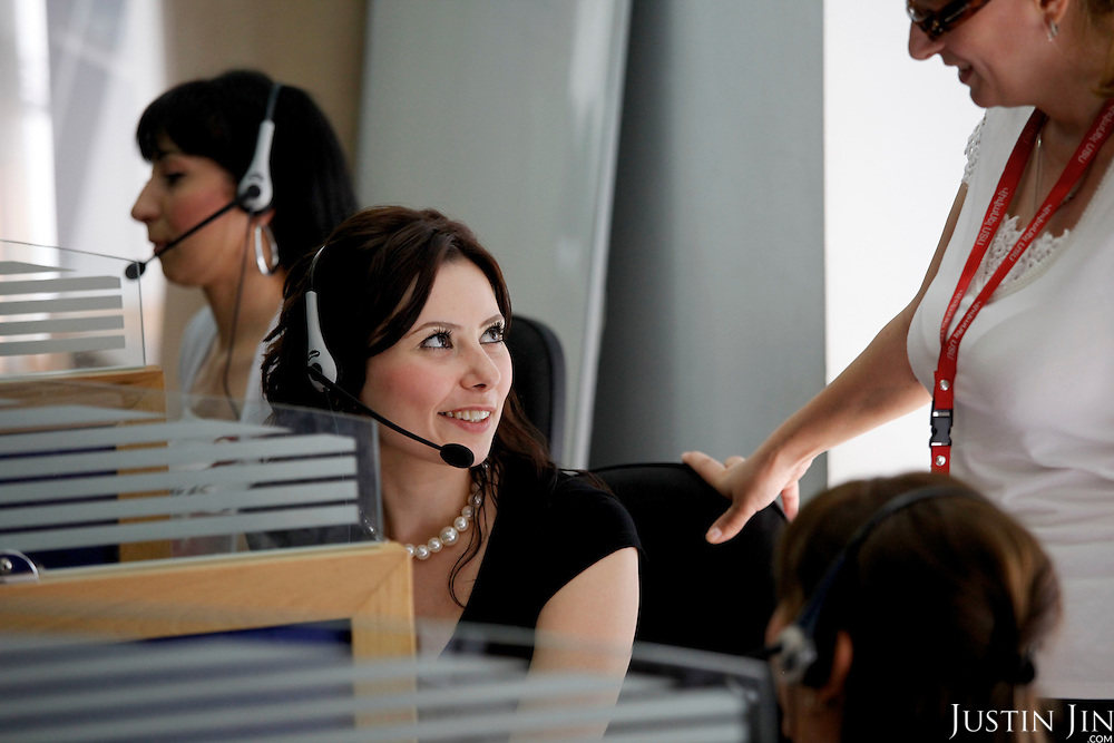 Helpdesk workers talk at VivaCell- Armenia in Yerevan, the capital of Armenia.