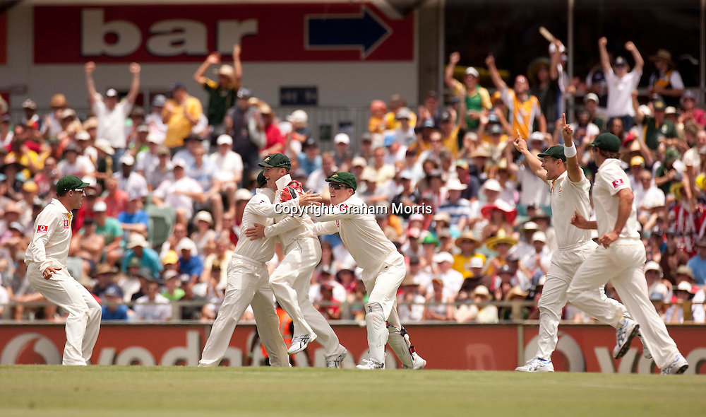 Last man Steven Finn out to Ryan Harris as England lose the third Ashes test match to Australia at the WACA (West Australian Cricket Association) ground in Perth, Australia. Photo: Graham Morris (Tel: +44(0)20 8969 4192 Email: sales@cricketpix.com) 19/12/10