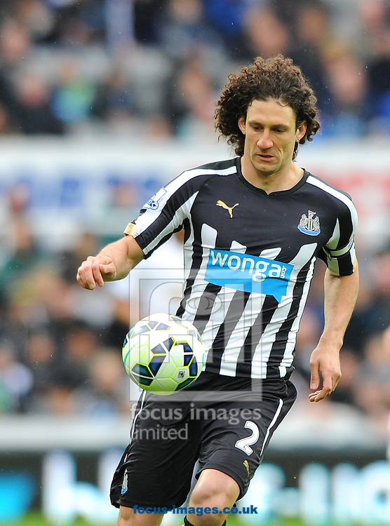 Fabricio Coloccini of Newcastle United controls the ball during the Barclays Premier League match at St. James' Park, Newcastle<br /> Picture by Greg Kwasnik/Focus Images Ltd +44 7902 021456<br /> 25/04/2015