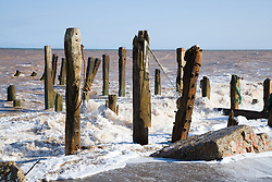Waves crashing onto a groyne at Spurn Head; East Yorkshire; which is being eroded by the sea,
