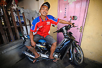 Buyung in Jongaya leprosy settlement, Makassar, Sulawesi, Indonesia. Buyung, 29, is single and has lived in Jongaya with his family since he was 3.  His parents moved to the settlement from Gowa, Sulawesi, after his father discovered he had leprosy.  Buyung himself found out he was infected with the disease when he was 10 but received prompt medical treatment and has no after effects from the infection.  He now runs a small motorbike repair business in Jongaya and also volunteers for Permata.