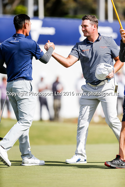 Danny Lee (NZL) and teammate Ryan Fox (NZL)  congratulate each other at the end of their round during the round 1 of the World Cup of Golf at Kingston Heath Golf Club, Melbourne Australia. Thursday 24th November 2016. Copyright Photo Brendon Ratnayake / www.photosport.nz