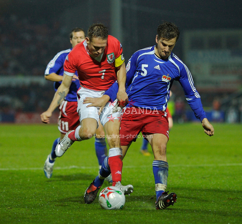WREXHAM, WALES - TUESDAY, NOVEMBER 14th, 2006: Wales' Craig Bellamy and Liechtenstein's Christof Ritter during the International Friendly match at the Racecourse Ground. (Pic by David Rawcliffe/Propaganda)