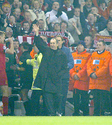 LIVERPOOL, ENGLAND - Tuesday, March 19, 2002: Liverpool's manager Gerard Houllier and assistant Phil Thompson celebrate their side's 2-0 victory over AS Roma during the UEFA Champions League Group B match at Anfield. (Pic by David Rawcliffe/Propaganda)