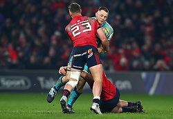 Jonny Hill of Exeter Chiefs is tackled by CJ Stander and Dan Goggin of Munster Rugby - Mandatory by-line: Ken Sutton/JMP - 19/01/2019 - RUGBY - Thomond Park - Limerick,  - Munster Rugby v Exeter Chiefs -