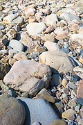 No rain in Spain - signs of drought, rocks in a dried up riverbed in Spain