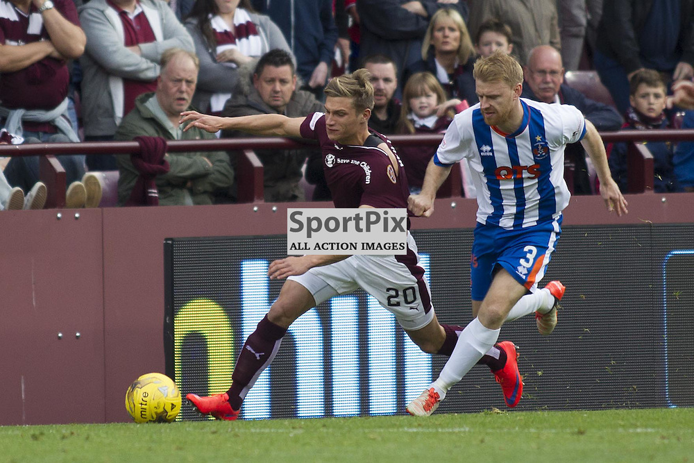 Gavin Reilly of Hearts gets tackled by Steven Smith of Kilmarnock during the Ladbrokes Scottish Premiership match between Heart of Midlothian FC and Kilmarnock FC at Tynecastle Stadium on October 3, 2015 in Edinburgh, Scotland. Photo by Jonathan Faulds/SportPix