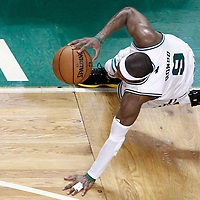 07 June 2012: Boston Celtics point guard Rajon Rondo (9) falls during first half of Game 6 of the Eastern Conference Finals playoff series, Heat at Celtics at the TD Banknorth Garden, Boston, Massachusetts, USA.