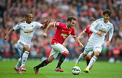 16.08.2014, Old Trafford, Manchester, ENG, Premier League, Manchester United vs Swansea City, 1. Runde, im Bild Manchester United's Juan Mata in action against Swansea City // 15054000 during the English Premier League 1st round match between Manchester United and Swansea City AFC at Old Trafford in Manchester, Great Britain on 2014/08/16. EXPA Pictures &copy; 2014, PhotoCredit: EXPA/ Propagandaphoto/ David Rawcliffe<br /> <br /> *****ATTENTION - OUT of ENG, GBR*****