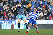 Sheffield Wednesday Defender Glenn Loovens and Reading Yann Kermorgant battle during the Sky Bet Championship match between Reading and Sheffield Wednesday at the Madejski Stadium, Reading, England on 23 January 2016. Photo by Phil Duncan.